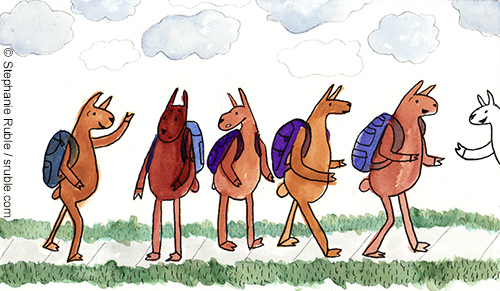 5 llamas in shades of yellow and brown walking (upright) down the sidewalk wearing blue or purple backpacks, and one white llama leaning into the picture from the right, no backpack visible, with a cloudy sky and grass on wither side of the sidewalk